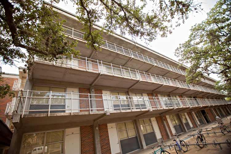 Hughes Hall exterior at angle with bike racks