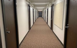 New hallway lighting and carpeting in Davis-Gary