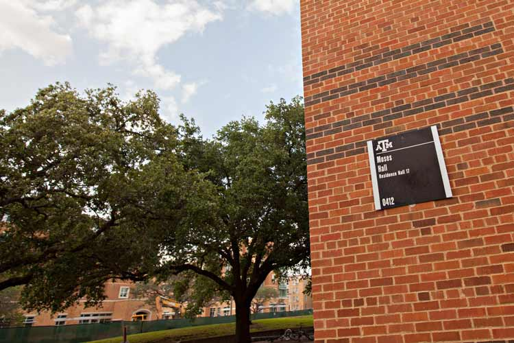 Moses Hall building signage and green space