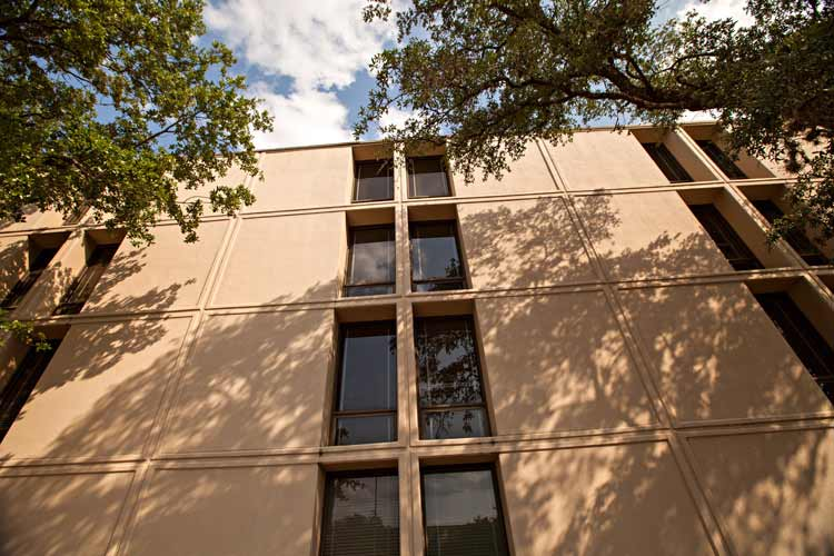 Haas Hall exterior with window and tree shadow cast on side of building