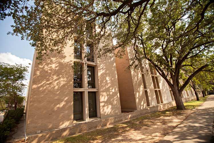 Haas Hall exterior under tree shade