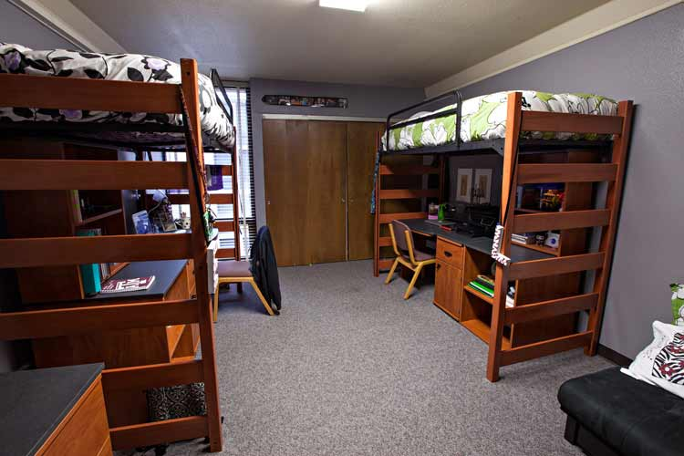 McFadden Hall student room interior with two lofted beds with desks under