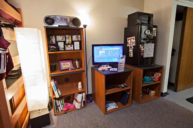 Rudder Room with student belongings and bookshelf