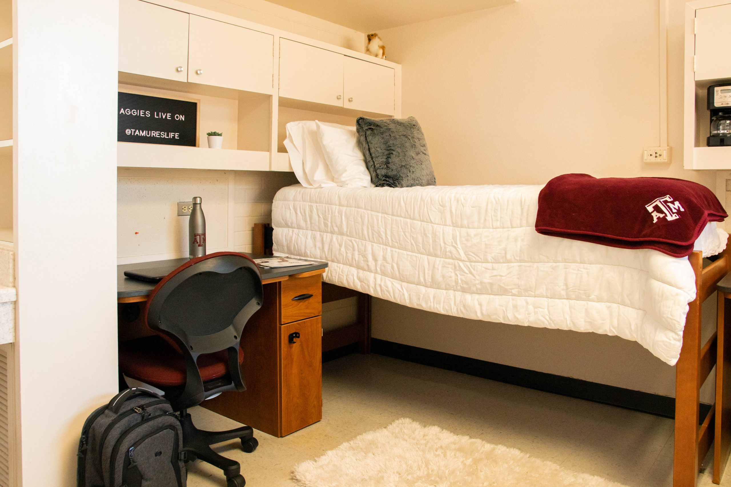 1 lofted bed, 1 study desk and chair, 2 cabinets
