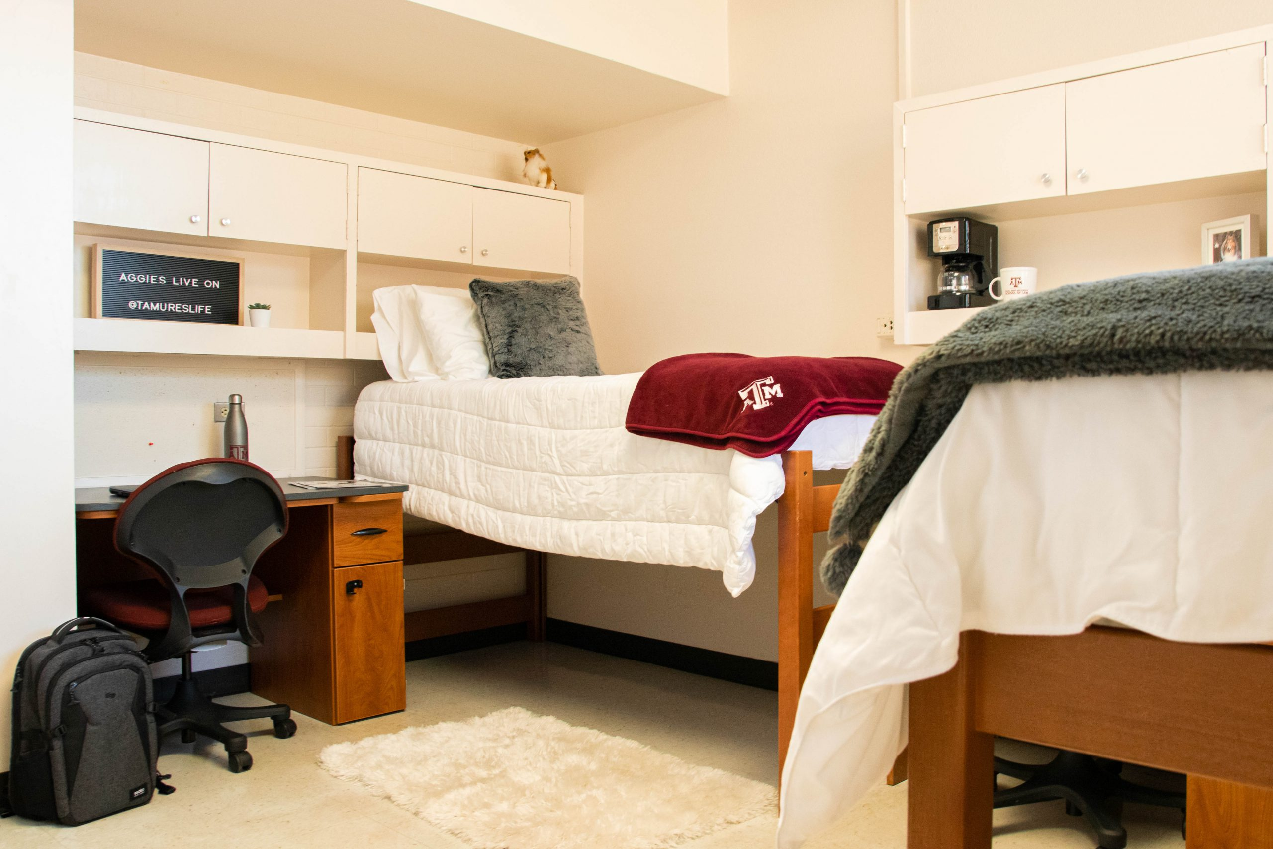 2 lofted twin-size beds, one study desk and chair, 3 cabinet storage spaces above beds