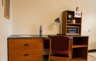 One study desk that is attached to a drawer, and two storage cabinets. One study chair
