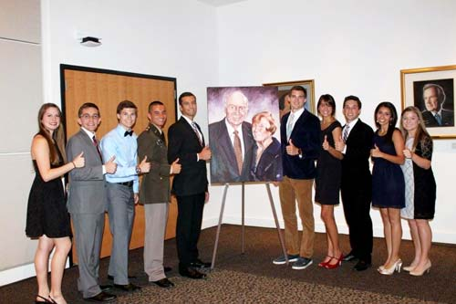 Terry Scholars recipients with a portrait of the donors